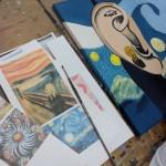 miembros de ASAPME pintando El viaje de NEI